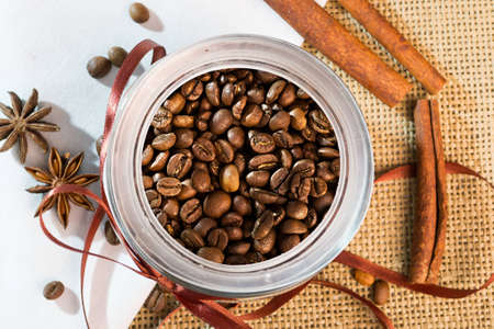 Open a bank with coffee beans lying on sackcloth and napkins Stock Photo - 12590372