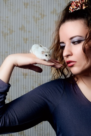 Girl with a hamster on a hand Stock Photo - 13467920