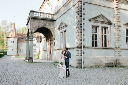 wedding beautiful couple in the evening in a castle