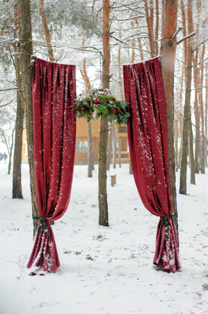 Arch for wedding ceremony made of red color.