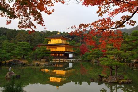 Kinkakuji in autumn season - the famous Golden Pavilion at Kyoto, Japan.