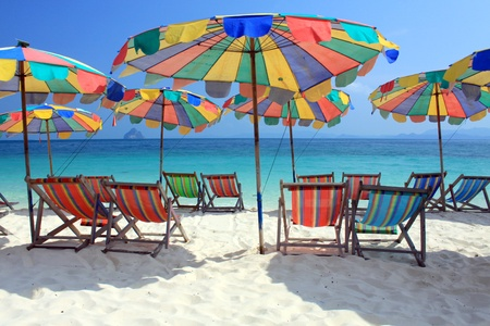 Beach chair and colorful umbrella on the beach , Phuket Thailand  Stock Photo