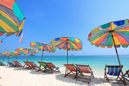 beach umbrella: Beach chair and colorful umbrella on the beach , Phuket Thailand  Stock Photo