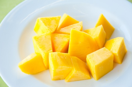 Mango on white dish : Most popular and delicious Thai fruit