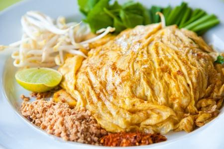 Stir-fried rice noodles with egg, and shrimp (Pad Thai)