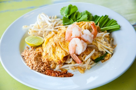 Stir-fried rice noodles with egg, and shrimp (Pad Thai) photo