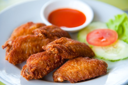 deep fried spicy chicken wing with chili sauce photo