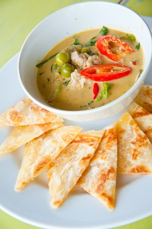 kind of Indian food made of flour with chicken green curry : Traditional Indian food photo