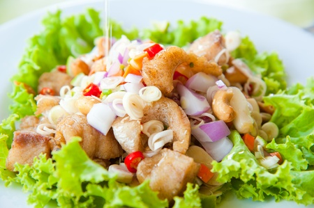 prawns: Thai dressed spicy salad with bass, green herbs and nuts : delicious food Stock Photo
