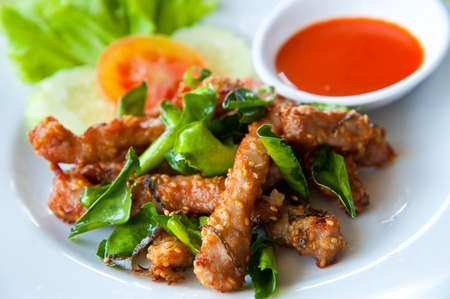 stir fry: Deep fried pork with leech lime leaf and chili sauce Stock Photo