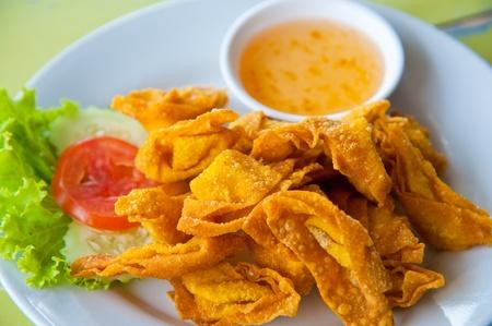 Deep Fried Wonton on white dish with plum sauce