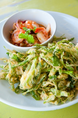 deep fried morning glory with spicy shrimp salad photo