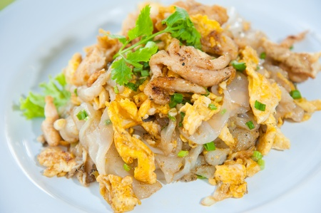 Stir fried noodles with egg, pork, green vetgetables, and sweet soy bean sauce
