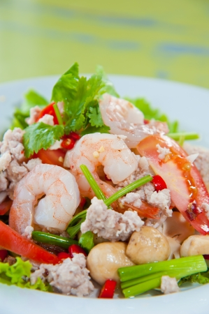 Thai dressed spicy salad with prawn, pork, green herbs and nuts : delicious food Stock Photo - 10193329