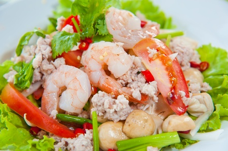 Thai dressed spicy salad with prawn, pork, green herbs and nuts : delicious food