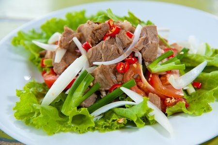 Spicy salad with pork and green herb in Thai style photo