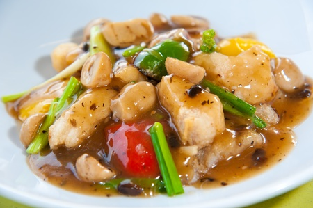 black dish: Stir-fried colorful vegetables, mushroom and herb Stock Photo