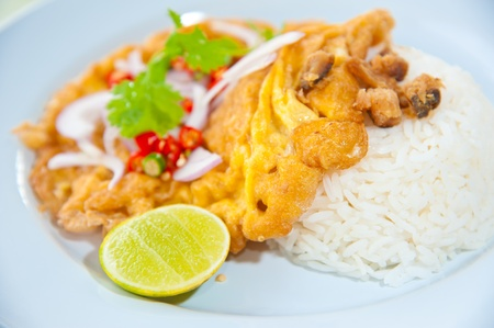 Delicious traditional Thailand food : Hot rice with omelet, pork, green herbs and chili sauce