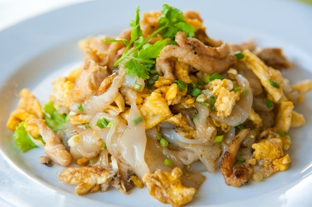 Stir fried noodles with egg, pork, green vetgetables, and sweet soy bean sauce photo