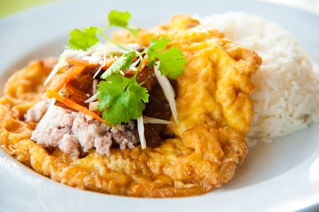 omelet: Delicious traditional Thailand food : Hot rice with omelet, pork, green herbs and chili sauce