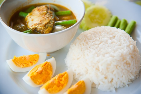Delicious Thailand traditional food : hot rice with vegetables, curry and boil egg photo