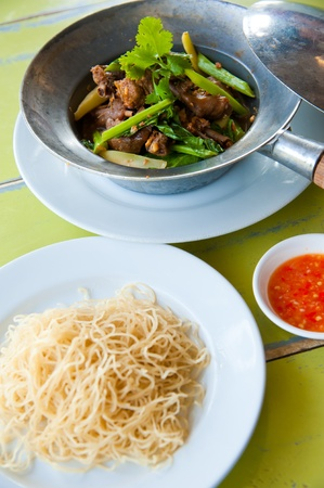 baked goose with green beans ,potato,red pepper , green herbs, chinese noodle and sauce photo
