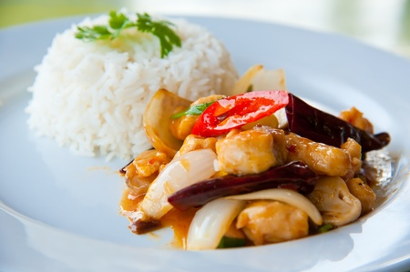 delicious hot rice with fried pork, onion, chili, vegetables and green herbs photo