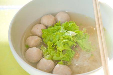 Asian cuisine, rice noodles with fish ball and meat ball photo