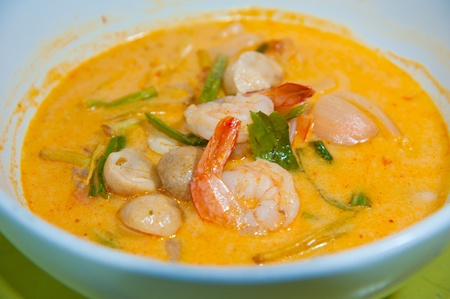 Traditional Thai delicacy made from jumbo shrimps, Thai noodles and prepared with select spices. Garnished with finely chopped green onions (Guay Tiao Tom Yum) photo
