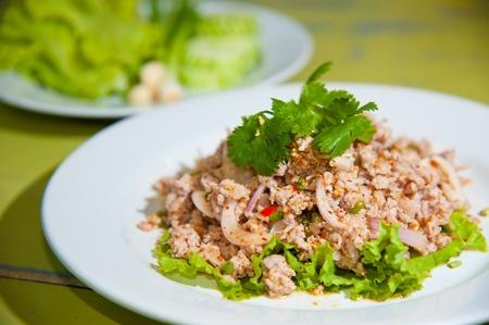 Larb chicken salad. Traditional Thai food, with ground chicken lime, chili and herbs. This food is popular in the north-east of the country (Isaan)
