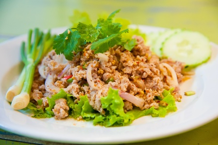 Larb chicken salad. Traditional Thai food, with ground chicken lime, chili and herbs. This food is popular in the north-east of the country (Isaan) Stock Photo - 10280656