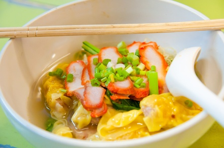 Egg chinese dry noodles with roast red pork, dumpling and vegetables Stock Photo