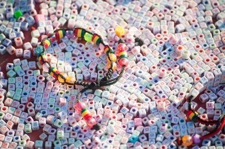 Textures of colorful plastic bracelet on many letter plastic cubic, Nepal. photo
