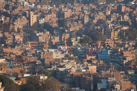 An evening cityscape of many buildings of Kathmandu City, Nepal. View from Swayambhunath pagoda photo