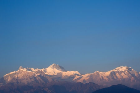 Beautiful evening view and sunset time of the Himalayan mountains when see from Sarangkot, Pokhara, Nepal photo
