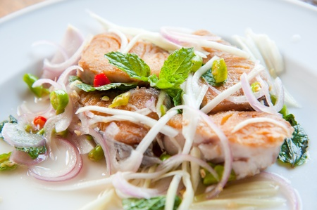 Spicy salad with fried fish and green herb in Thai style Stock Photo - 13209637