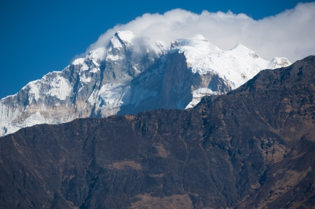 Beautiful view of Himalayan mountains with snow in morning when see from Ghorepani Village, Poon Hill Trekking way, Nepal photo