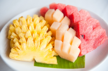 A plate of famous tropical fruits   Pineapple, Cantaloupe and Watermelon photo