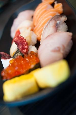 Close up of Variety Sushi Set on Black Dish photo