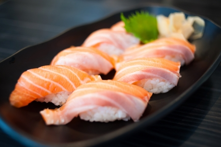 Close up of Salmon Sushi Set on Black Dish Stock Photo - 16634936