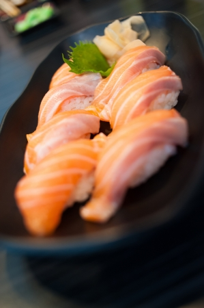 Close up of Salmon Sushi Set on Black Dish photo
