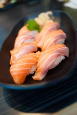 Close up of Salmon Sushi Set on Black Dish photo