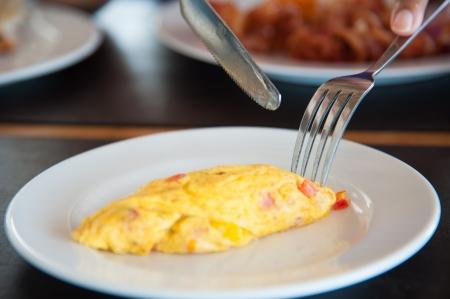 Omelete egg on white dish Standard-Bild