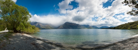 newzealand: Beautiful panorama view of lake and mountain in blue sky near Queenstown, South Island, New Zealand