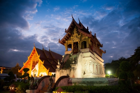 Beautiful temple and buddha with twilight sky   Wat Phra Sing Waramahavihan at Chiangmai Thailand Stock Photo