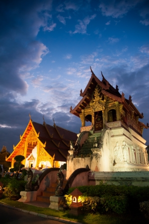 Beautiful temple and buddha with twilight sky   Wat Phra Sing Waramahavihan at Chiangmai Thailand photo