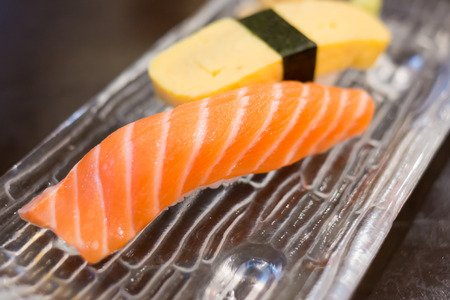 Close up salmon sushi and  Tamagoyaki photo