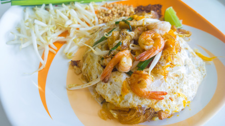 Thailand s national dishes, stir-fried rice noodles with egg, vegetable and shrimp  Pad Thai  photo