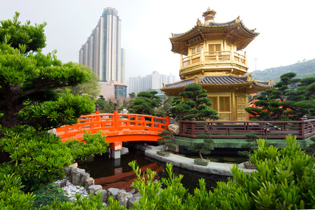 The Golden pavilion and red bridge in Nan Lian Garden near Chi Lin Nunnery, famous landmark in Hong Kong