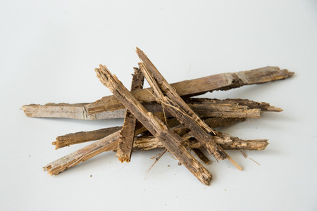 roughness: stack of firewood isolated on white background